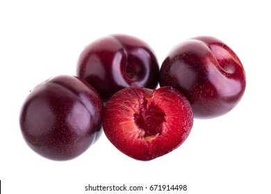 ripe fresh plum with half and slice isolated on white background.