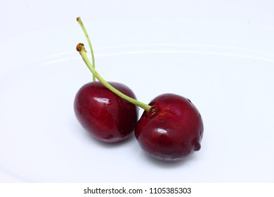 Ripe fresh red cherry isolated on white background.