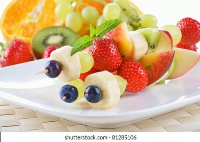 Ripe fruit in season on skewers