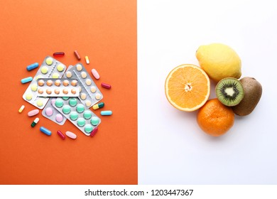 Ripe fruits and pills in blister on colorful background