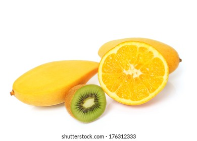 Ripe golden mangoes orange and kivi fruits on white background