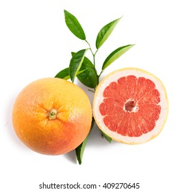 Ripe grapefruit with leaves isolated on white background
