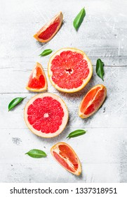 Ripe grapefruit with leaves. On rustic background