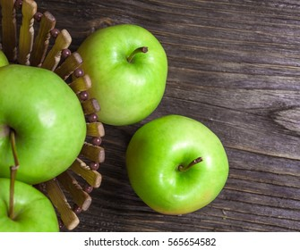 ripe green apples and apple slices on wooden gray background