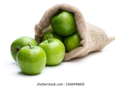 Ripe  green apples in sakcloth bag isolated on white