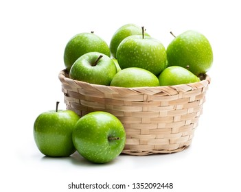 Ripe  green apples in wicker basket isolated on white