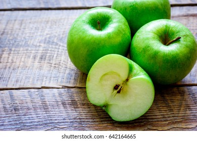 ripe green apples wooden table background