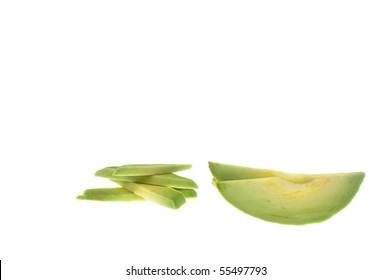 ripe green avocado slice over white isloated