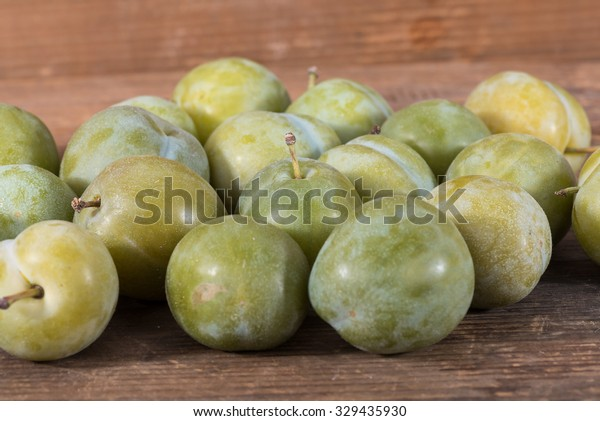 Ripe greengage on wooden background