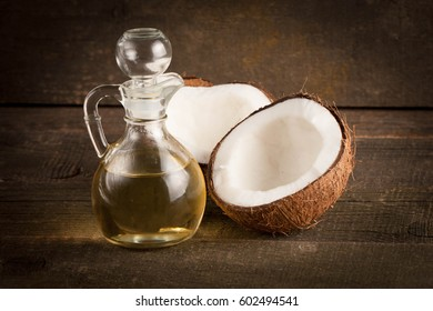 Ripe half cut coconut on a wooden background. Ripe half cut coconut on a wooden background. Coconut cream and oil.
