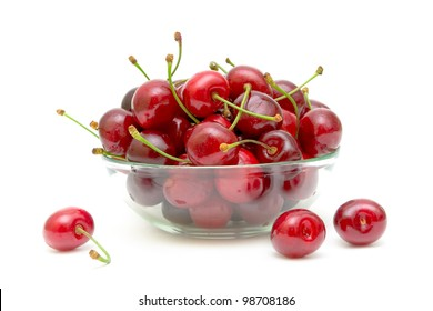 ripe and juicy cherries in a glass bowl on a white background close-up
