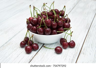 Ripe juicy cherries on a wooden background