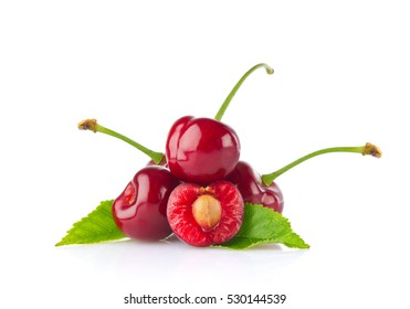 Ripe juicy cherry with green leaf. Isolated on white background
