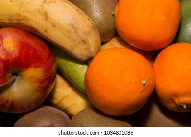 Ripe juicy fruit close-up: tangerines, bananas, apples, kiwi, pears