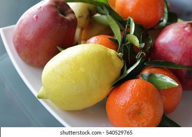 Ripe juicy fruits on a dish