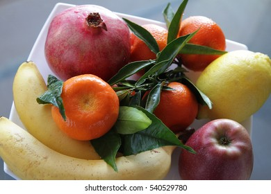 Ripe juicy fruits on a dish