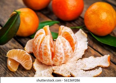 ripe and juicy mandarines (tangerine) and green leaves