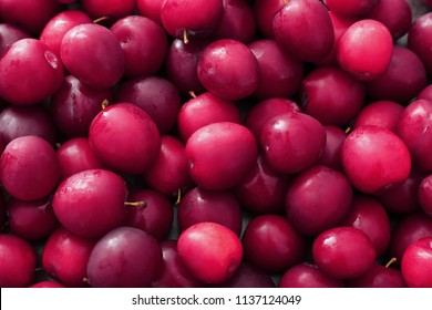 Ripe juicy plums as background