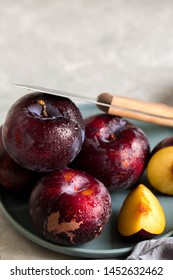 Ripe, juicy plums Ripe, juicy plums. Washed plums cut with a knife.Vegetarian food.