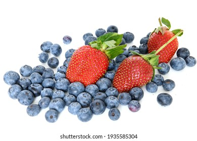 Ripe juicy strawberries and garden blueberries on white background