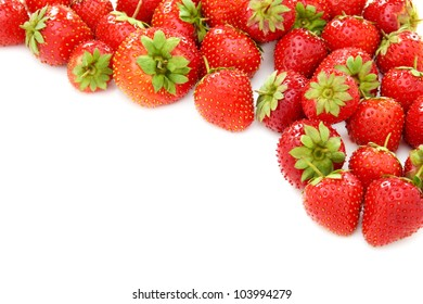 Ripe juicy strawberries on a white background.