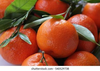 Ripe juicy tangerines on a dish