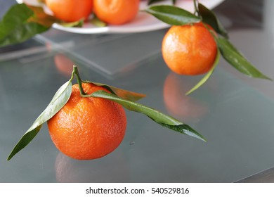 Ripe juicy tangerines on a dish