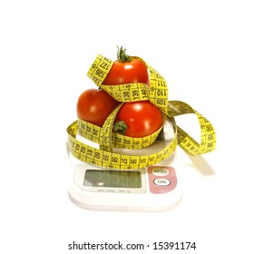 Ripe juicy tomato and tape measure isolated