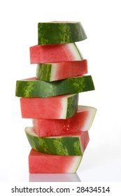 Ripe, juicy, watermelon slices stacked up on top of each other