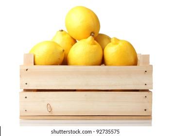 ripe lemon in wooden box isolated on white