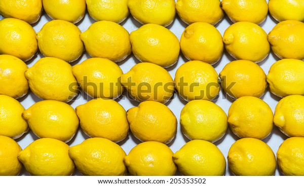 Ripe lemons, background on the shop counter