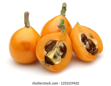 Ripe loquat, half and slice isolated on white background