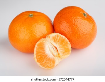 Ripe mandarin close-up on a white background. Tangerine orange. Colorful Food and drink still life concept. Fresh fruits and vegetables on color background. Clementine. Citrus. Fresh fruits. Diet.