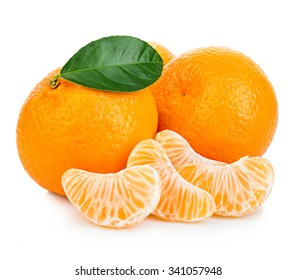 Ripe mandarin with leaves close-up on a white background. Tangerine orange with leaves on a white background.