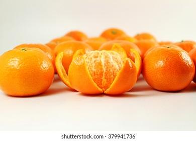 Ripe mandarin  tangerine orange closeup on a white background