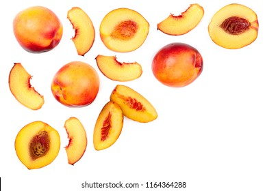 ripe nectarine with leaves isolated on white background with copy space for your text. Top view. Flat lay pattern