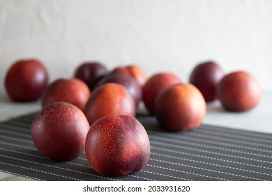 Ripe nectarines on a gray table. Soft focus.