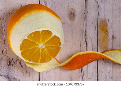 Ripe orange peeled on old wooden background