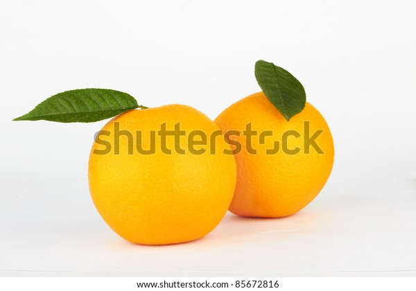 ripe oranges with leaf on white