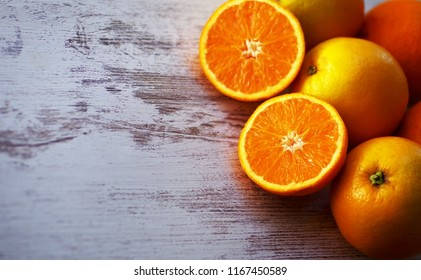 ripe oranges on a wooden background