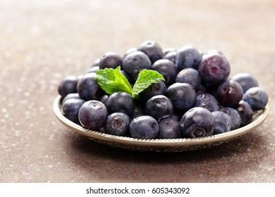 Ripe organic berry blueberries on a plate