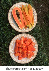 ripe papayas are on a plate background.