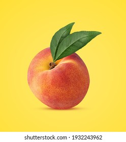 Ripe peach fruit with green leaf isolated on yellow background. Clipping Path