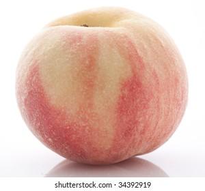 Ripe peach, shot on white