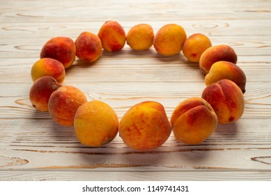 ripe peaches on lined in a circle