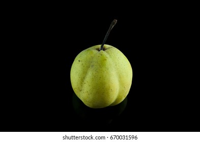 Ripe Pear Fruit over black background
