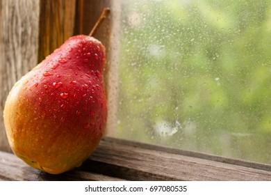 Ripe pear on a wooden window