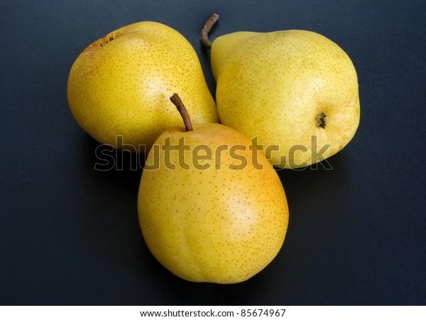 ripe pears on dark background