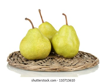 Ripe pears on a wicker mat isolated on white