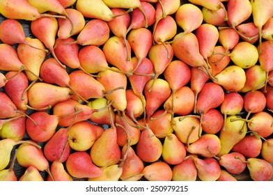 Ripe pears uniform background.